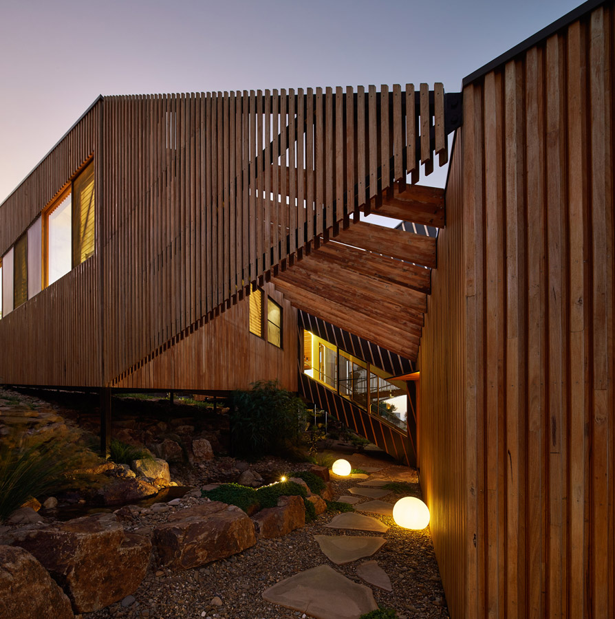 Overend Constructions, Split House, entrance path and facade closeup, dusk, timber and stone, BKK Architects