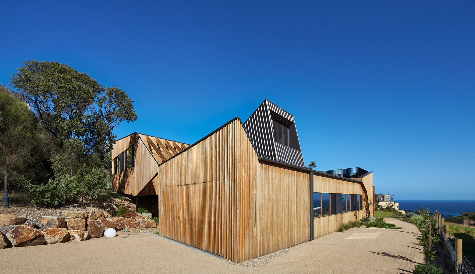 Overend Constructions, Split House, exterior timber facade with view to sea, BKK Architects