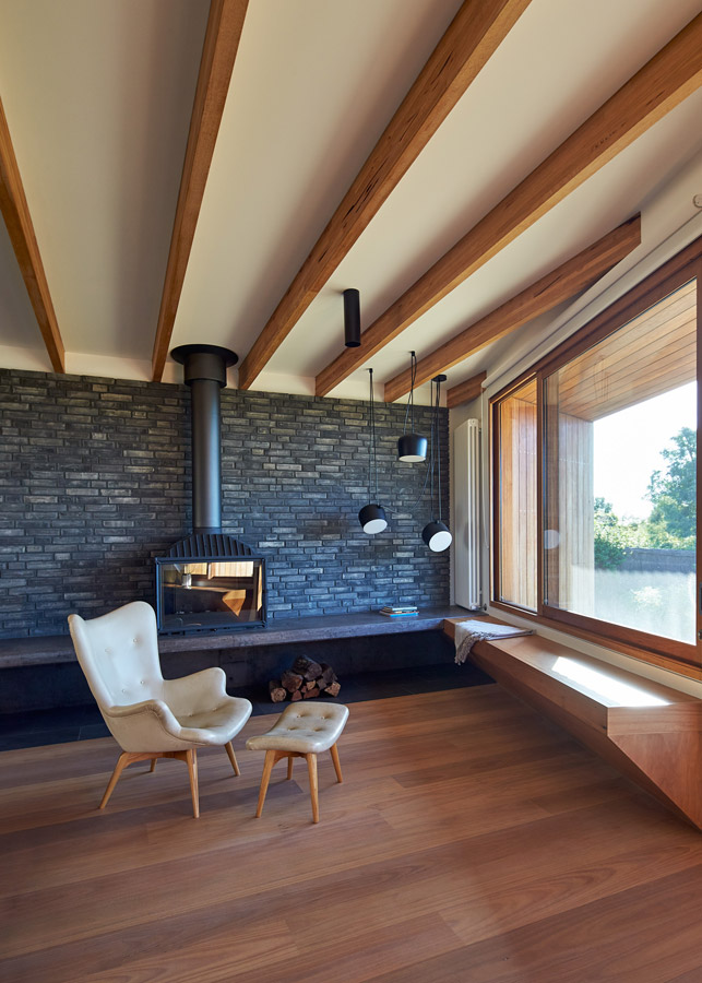 Overend Constructions, Split House, corner featuring fireplace, timber bench seating and timber floor, BKK Architects