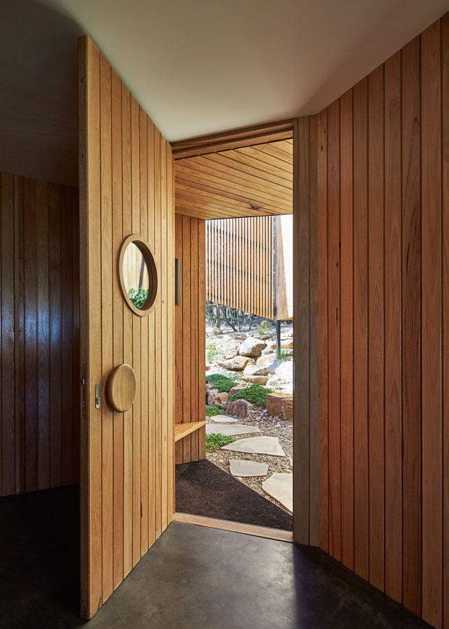 Overend Constructions, Split House door feature, round handle and porthole, timber, BKK Architects