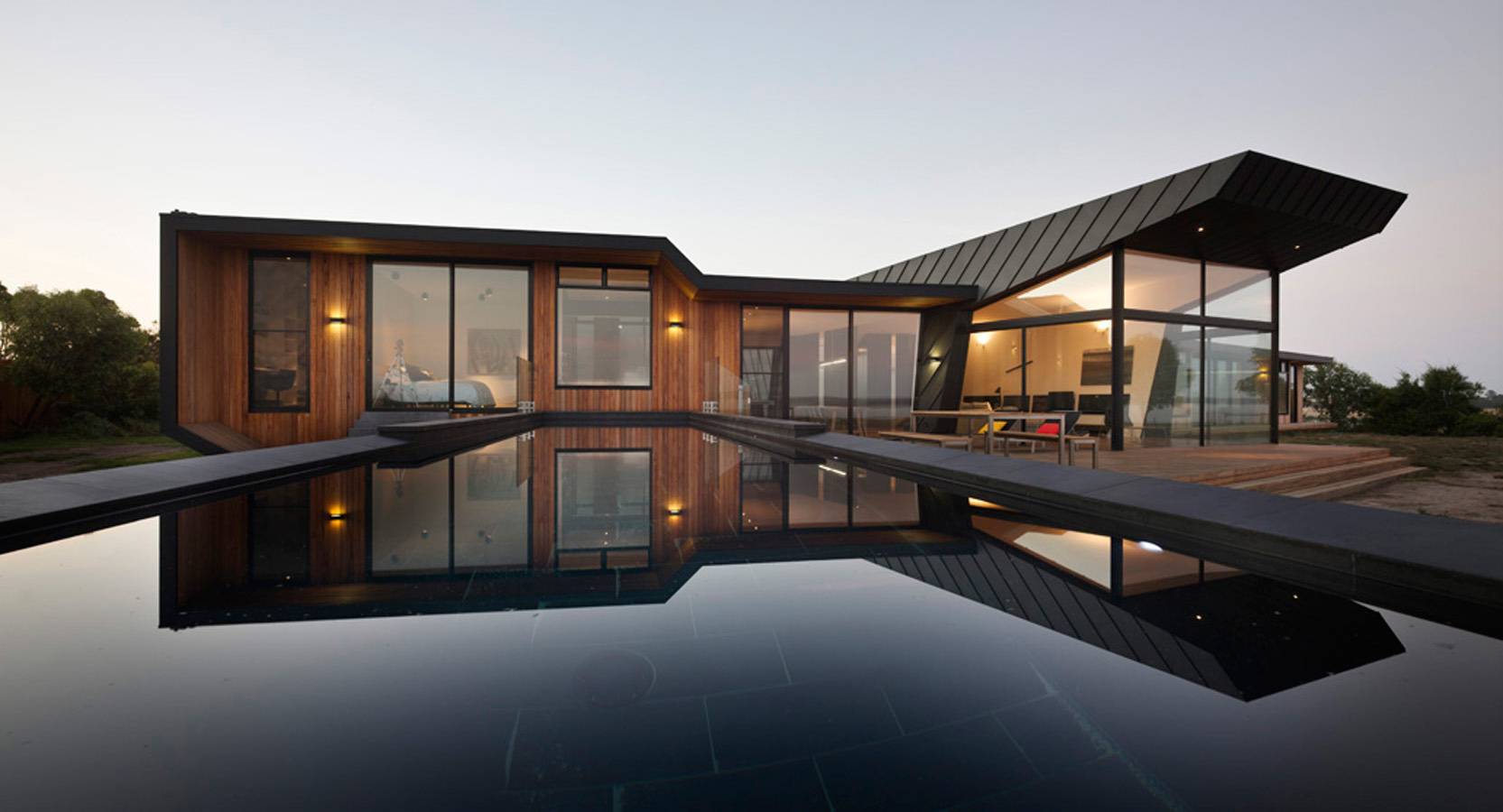 Overend Constructions, Beached House, exterior view from pool level, large windows and timber feature