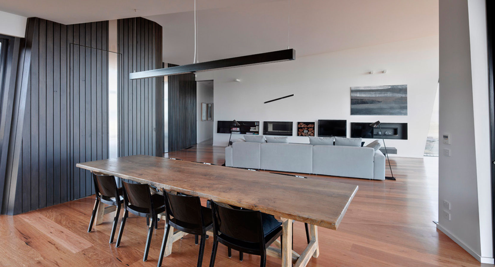 Overend Constructions, Beached House, dining through to lounge view, black and natural timbers featured