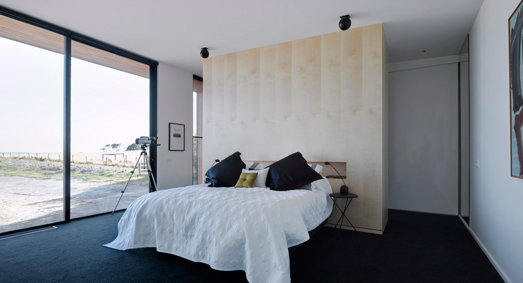 Overend Constructions, Beached House, bedroom with large glass windows and feature wall behind bed