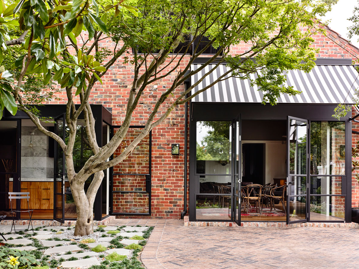 Overend Constructions, Kew II, Kennedy Nolan, red brick facade, steel glass doors, view to dining