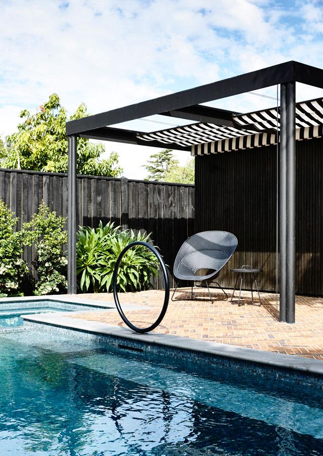Overend Constructions, Kew II, Kennedy Nolan, inground tiled pool, black pergola, black-white striped awning