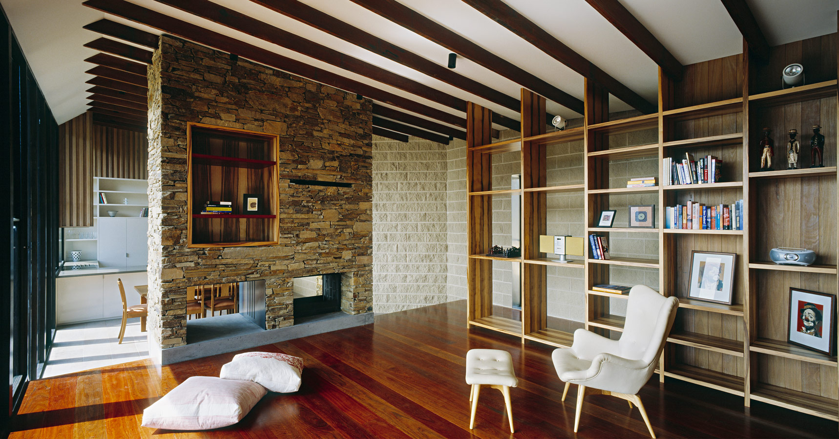 Great Wall House, lounge with stone fireplace, timber flooring, bespoke joinery shelving, BKK, Overend Constructions, design, architectural